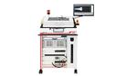 Die Teststation mit Adapter für den Prüfling und Monitor für die Benutzerführung