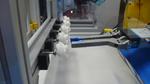 Die Detailaufnahme vermittelt einen Eindruck von der Präzision, die bei robotergestützten Pick&Place-Anwendungen erforderlich ist.