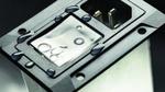 Kompakter Gerätestecker mit Schutzschalter und Filter