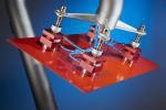 Der Magnetgreifer von Goudsmit Mag- netics dient zum automatisierten Auf- nehmen, Ablegen oder Positionieren von Stahlgegenständen oder anderen ferromagnetischen Gegenständen....
