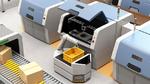 Bild 2. Führerloses Transportfahrzeug (Autonomous Guided Vehicle, AGV) mit einem Cobot zur Entnahme von Werkstücken aus einem Metall-3D-Drucker.