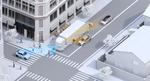 Bild 2. Ein Anwendungsbeispiel, bei dem adaptive Applikationen zum Einsatz kommen können: Ein parkender Lkw versperrt die Sicht auf andere Verkehrsteilnehmer. Systeme zur Kollisionsvermeidung können in solchen Fällen die Einschränkungen der menschlic