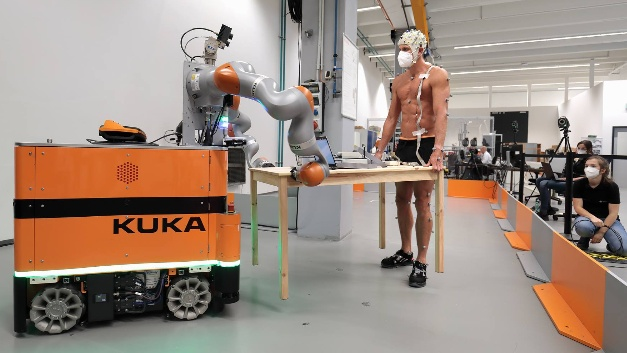 Psychological and social aspects of human-robot cooperation